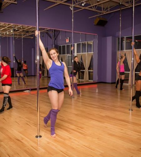 Pole dancing fitness studio breaking down preconceived notions