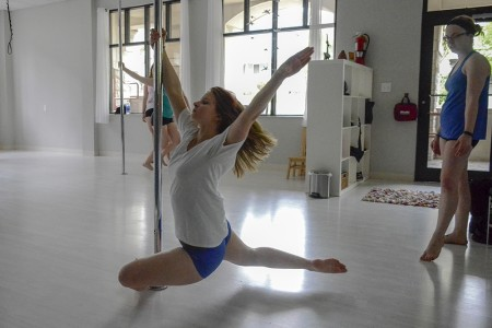 Sean MacLennan, senior, practices during her Monday pole dance class at Wild Orchid Aerial Fitness & Dance.