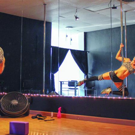 Studios strip stigma from pole fitness