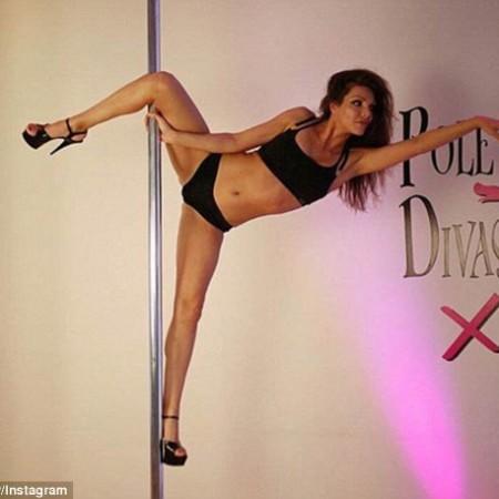 Former Bachelor contestant Natalie Sady shows off her pole dancing skills