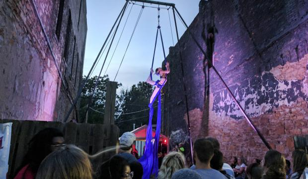 Aerialists perform in NOTO during First Friday Art Walk